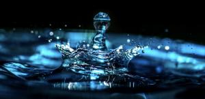 water drop hitting the water representing God's healing power