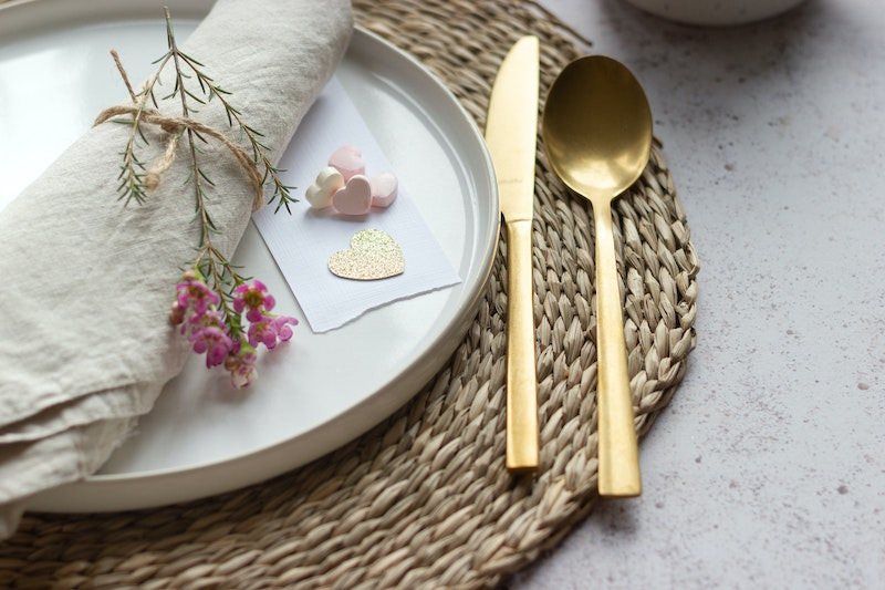 Table setting with a plate a knife and a spoon, biblical hospitality