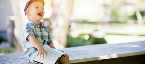 little boy on bench reading the bible, asking God