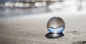 glass ball on beach, Christ healing, journey of self discovery